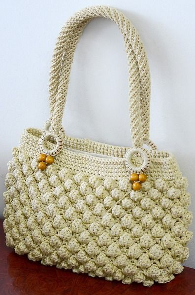 In store. Popcorn crochet stitch is made from Cream rope shade which decorate with wood bead and crochet flower. Inside include fabric and small pocket with zipper.