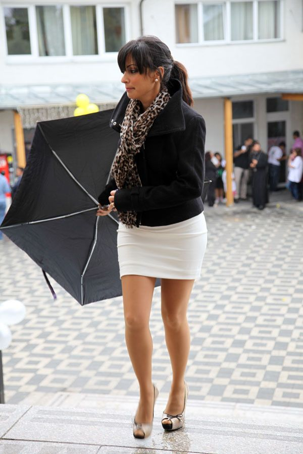 Mature Black Haired Woman Wearing A White Skirt With -5152