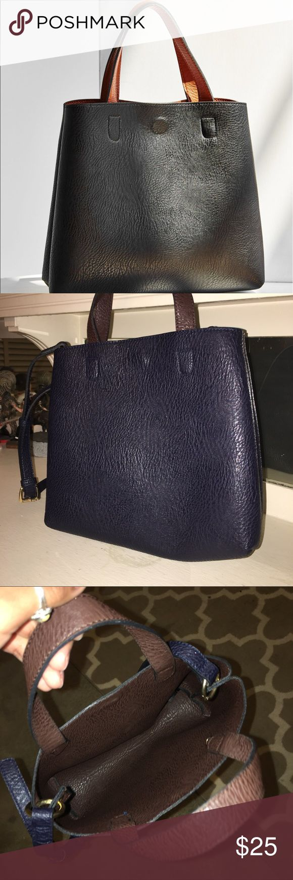 """Mini reversible vegan leather tote bag Worn a few times. Navy blue and dark brown. Adjustable strap. I do not have the clip on pouch. Length 12.5"""", width 3"""", height 9.7"""". There are no holes or tears. Great condition Urban Outfitters Bags Shoulder Bags"""