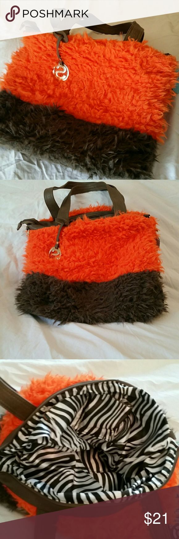 """Super Fluffy Handbag Your gonna love this beautiful fluffy handbag.   It has a dark tan and bright orange soft and fluffy material to it  16"""" across and 14"""" length, the strap has a 10"""" drop. Zippered Sarit Bags Totes"""