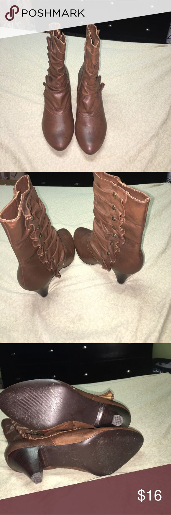 Carlos Santana boots Carlos Santana boots in pretty good condition there is a small flaw as shown in pictures. Other then that there Boots got a lot of life left in them. Purchased from Macy's from a smoke free home if u have any questions please ask ty Carlos Santana Shoes Ankle Boots & Booties