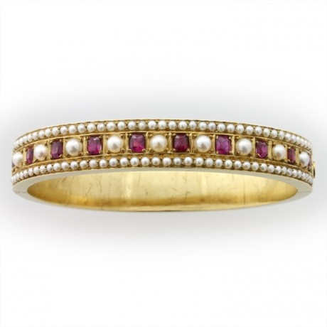 A mid-Victorian ruby and pearl bangle, c. 1860