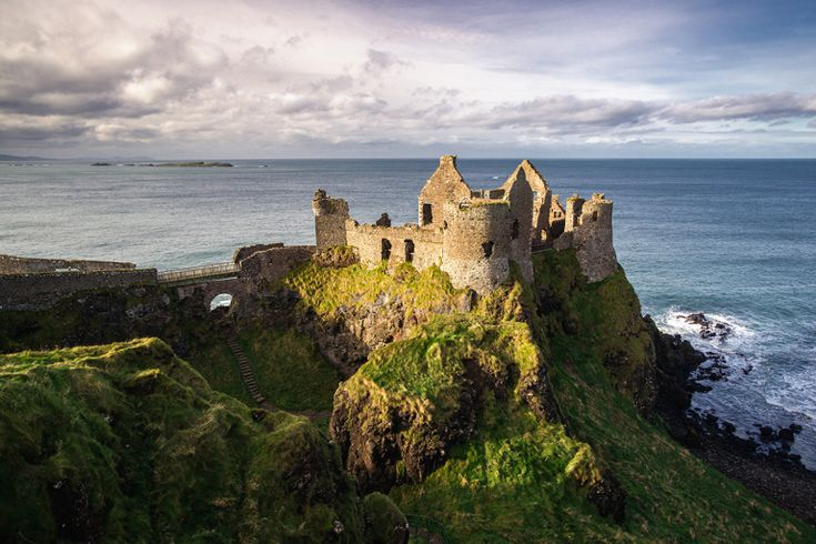 Dunluce Castle is located dramatically close to a headland that plunges straight into the sea, along the North Antrim coast, and was the headquarters of the MacDonnell Clan. Description from gettyimages.com. I searched for this on bing.com/images