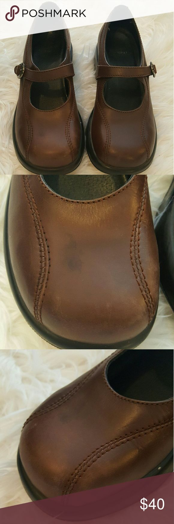 Dansko Brown Maryjane Shoes Brown Maryjane style Dansko shoes. There is a little wear and tear, but there is ALOT OF life left in these shoes. Dansko Shoes