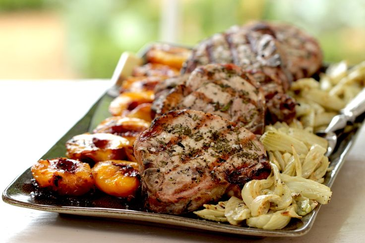 Grilled Pork Chops seasoned with fresh rosemary and served with grilled nectarines and roasted fennel. An easy Sunday night dinner idea!