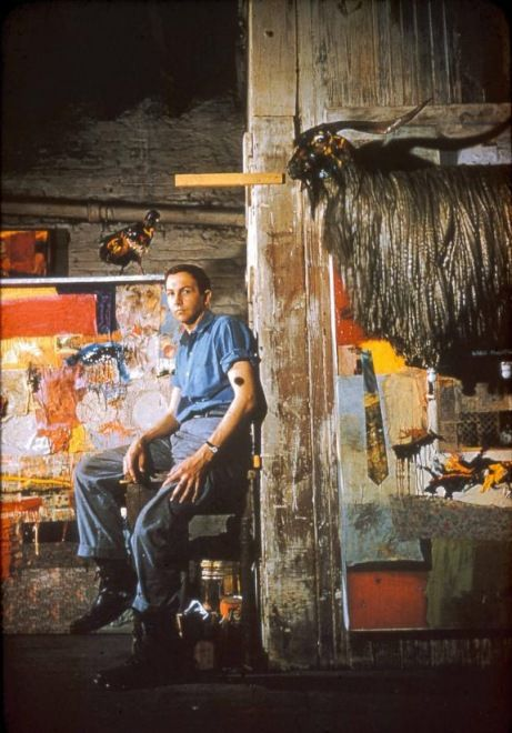Robert Rauschenberg Pearl Street studio, c.1955 - Rauschenberg in his Pearl Street studio with Satellite (1955) and the first state of Monogram (1955–59; first state 1955–56), New York, c.1955 - Photograph The Robert Rauschenberg Foundation (New York, USA)