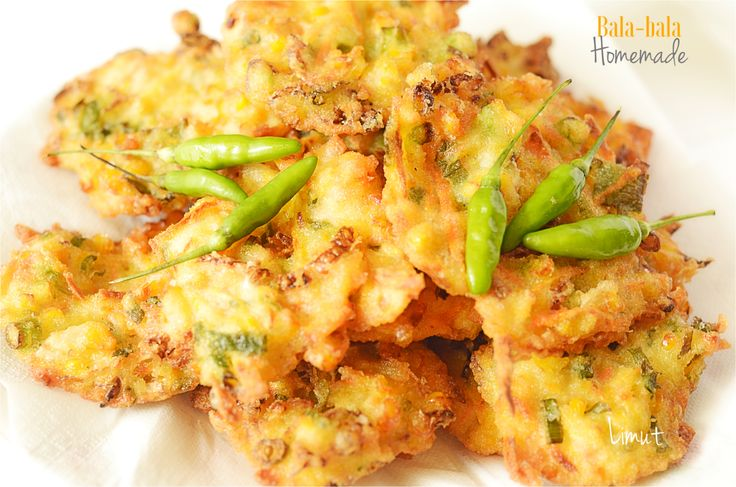 Bala-bala  It is Actually mix-vegetables fritter or tempura.  Some people call it Bakwan Sayur. It is made of mix vegetables, flour, some seasoning.  Normally, it is served hot with chilli paddy.  Be careful, it's addictive!