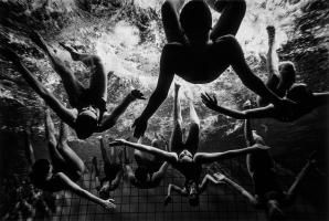 Synchronized swimming, once known as water ballet, has grown from its humble origins to become afully organized, internationally competitive sport, reaching the Olympics in 1984. It's afemale dominated discipline, though men compete internation...