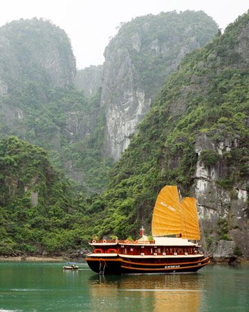 "Vietnam. ""Cruise around Halong Bay in a vintage-style wooden boat on the milky turquoise sea. Take in limestone karst islands and floating fishing villages. Excursions include kayaking and hiking for 360-degree panoramas (indochinasails.com)."""