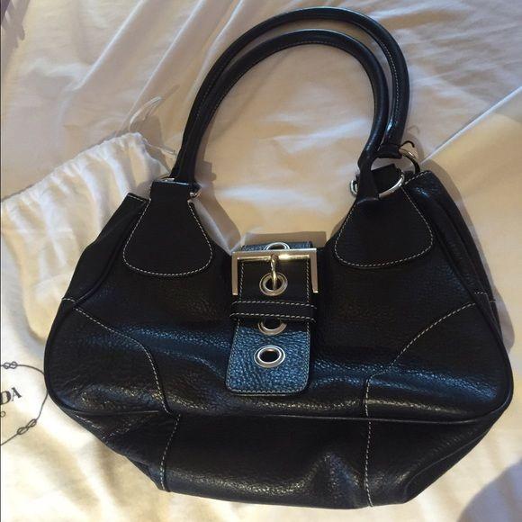 Black Prada Handbag Black leather Prada Handbag with buckle flap closure, inside zipper pocket Prada Bags