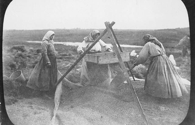 Doukhobor women winnowing grain in Saskatchewan in 1899. As an aside, the Doukhobors were persecuted in Russia for their pacifist and non-conformist views, and a large group of approximately 6,000 of them moved to Canada in 1899 with more following in subsequent years.