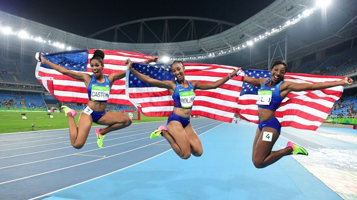 Bronze medallist USA's Kristi Castlin, gold medallist USA's Brianna Rollins and silver medallist USA's Nia Ali celebrate after the Women's 100m Hurdles Final during the athletics event at the Rio 2016 Olympic Games at the Olympic Stadium in Rio de Janeiro on August 17, 2016. (photo by Franck Fife, AFP/Getty Images)