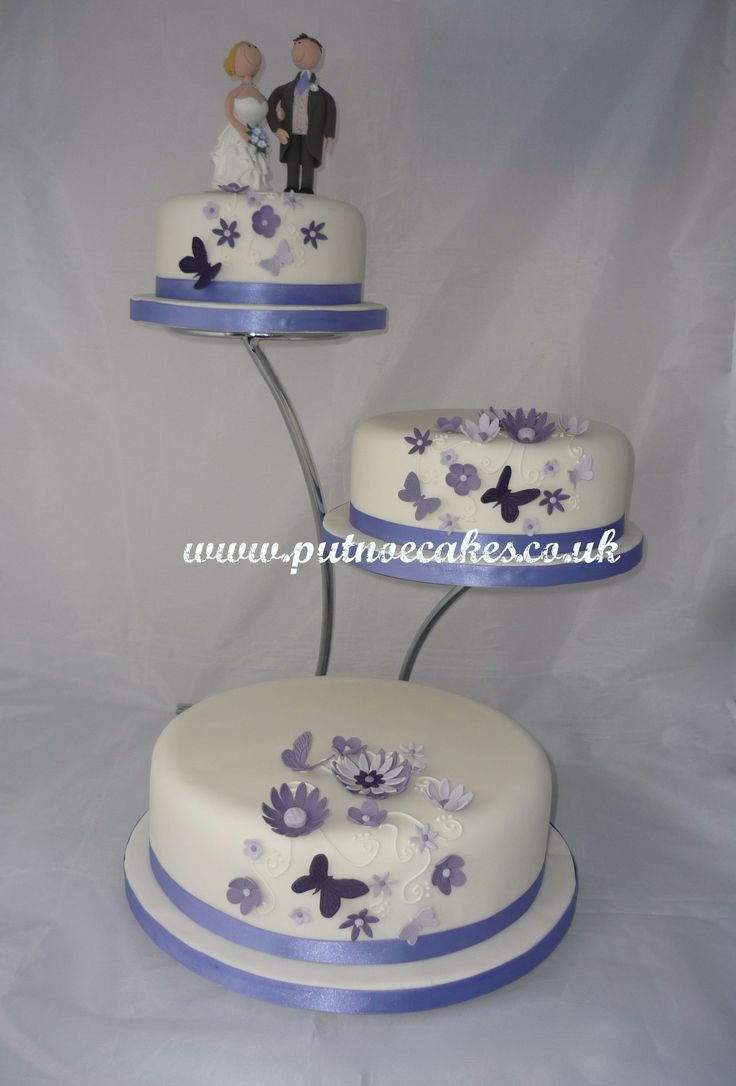 separate wedding cakes on stands and butterflies wedding cake 3 separated tiers on stand 19751