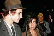 """FILE PHOTO dated August 24, 2007. """"Back to Black"""" singer Amy Winehouse has passed away. PICTURED: Amy Winehouse carries flowers as she leaves her birthday party at Century Club with ex-husband Blake Fielder-Civil."""