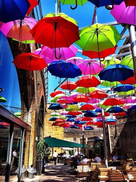 UMBRELLAS IN THE BOROUGH MARKET IN LONDON ON A SUNNY DAY.