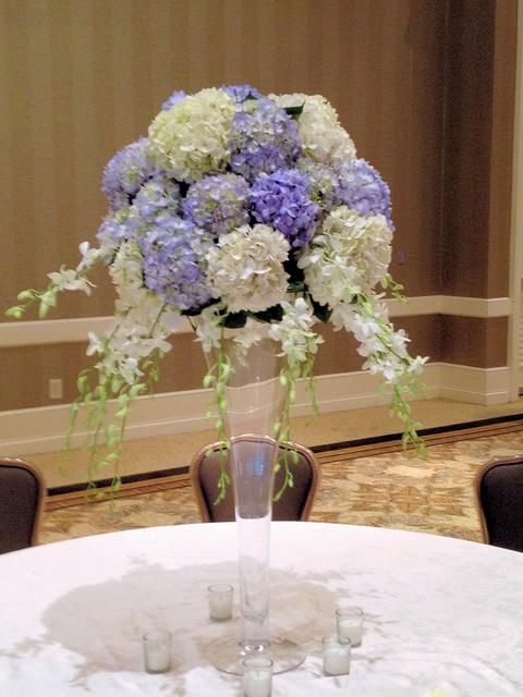 Centerpiece of hydrangeas and white dendrobium orchids