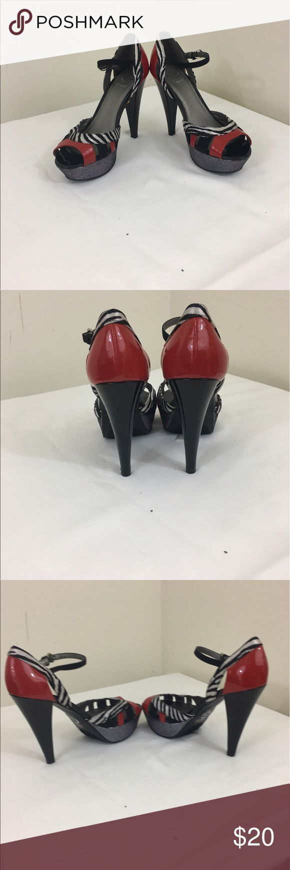 Guess women's Pumps size 8m. Red/White/Black Good condition    Has slight wear and may need slight cleaning Guess Shoes Heels