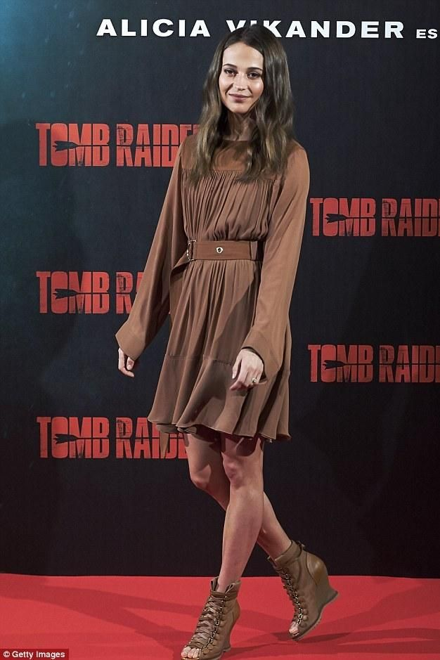 Alicia Vikander wearing Chloe River Boots and Chloe Pre-Fall 2018