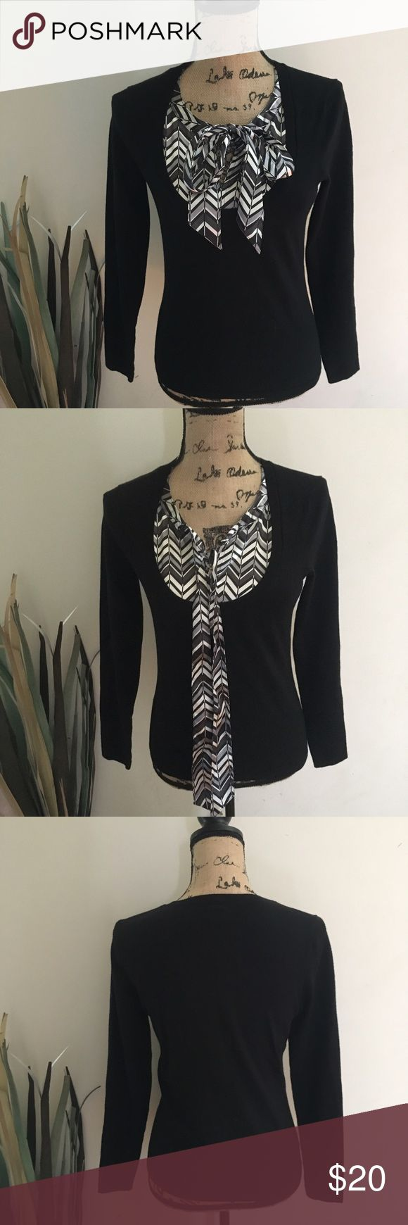 Ann Taylor black faux layered sweater Perfect for work! Black v neck sweater with faux layered silky top with tie neck. Sz small GUC with some minor pilling underarms. See last pic. No snags or holes. Nonsmoking home. Ann Taylor Tops