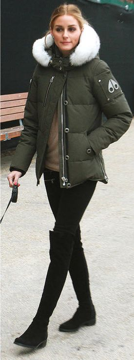 Olivia Palermo in a Moose Knuckles puffer coat, camel sweater, black pants and over-the-knee boots