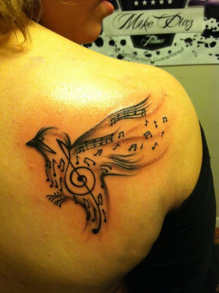 my music bird tattoo. right after it was done. i got this tattoo for my grandmother.  Mike Diaz - www.facebook.com/mikediaztattoo  (806) 782-5042