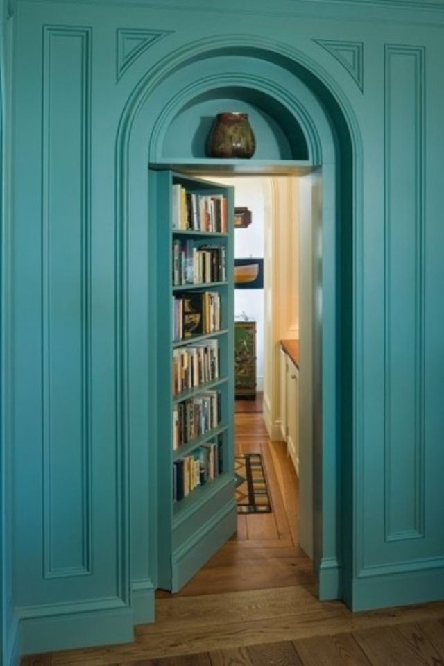Conceal an entire area with a 'wall of books' that actually opens up to a study room or office area.