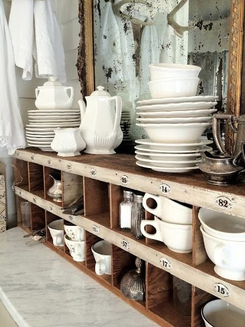 Love the mismatched combination of white dishes in the vintage cabinet.  #vintage #kitchendecorideas #countryrustic #rustichome #farmhouse