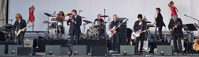 Bryan Ferry onstage at Guilfest 2012, with backing from Johnny Marr and Chris Spedding