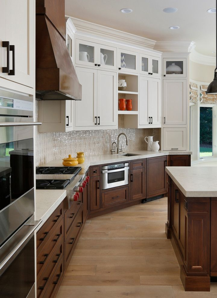 Engaging Two Tone Room Colors Image Decor in Kitchen Transitional design ideas with Engaging dark stained wood glass upper cabinets hood kitchen peninsula Natural Wood Floor