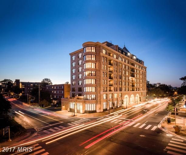 East facing w/. balcony.  Corner - living/dining el.  Kitchen feat. Bosch appl, quartz counters, HW flr.  HW in LR/DR & MBR.  Porcelain tiled baths. Full-sized w/d.  Master w/ walk-in and bay window. Across street from Harris Teeter/Starbucks.  Walk to Metro,Bethesda's restaurants, NIH & Walter Reed.  State-of-the-art fitness center, 2 roof terraces, Club room, concierge, 1 parking space included.