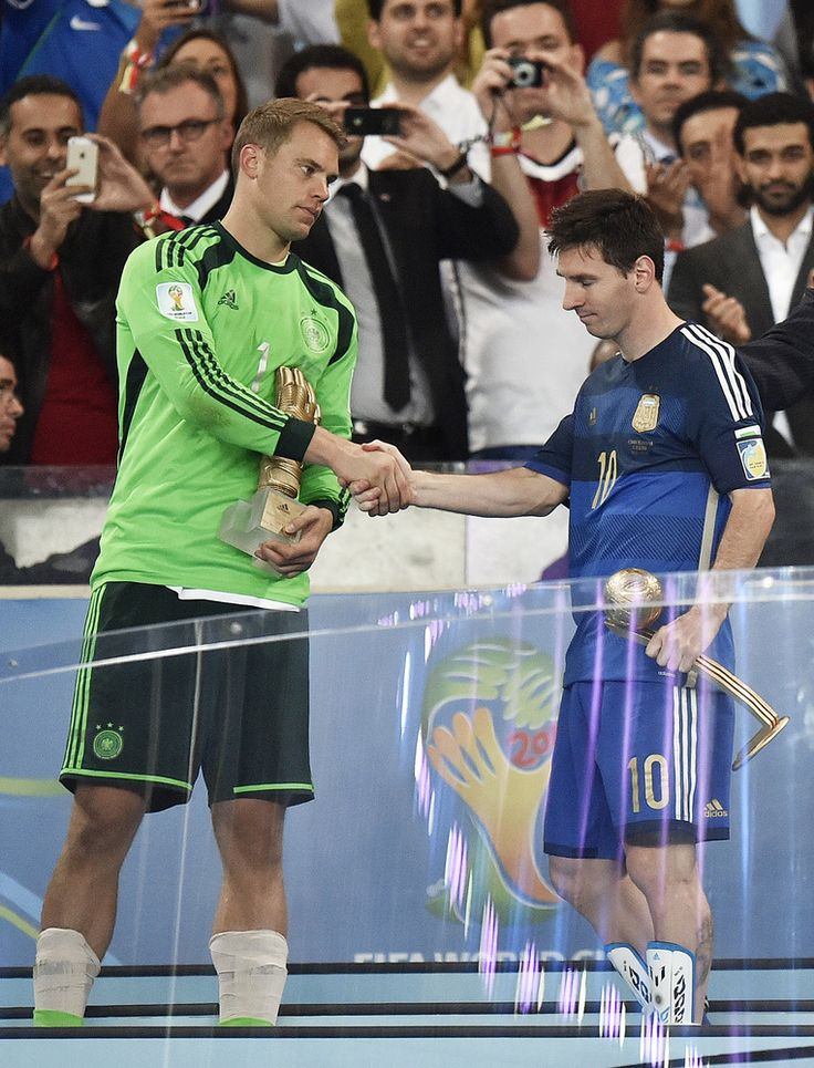 World Cup Final: Germany's goalkeeper Manuel Neuer, left, winner of the Golden Glove award for best goalkeeper, shakes hands with Argentina's Lionel Messi, winner of the Golden Ball award as the tournament's top player, after the World Cup final soccer match between Germany and Argentina at the Maracana Stadium in Rio de Janeiro, Brazil, Sunday, July 13, 2014. Germany won the match 1-0. (AP Photo/Martin Meissner)