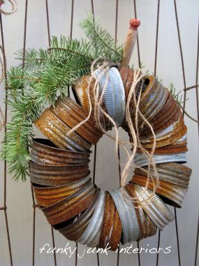 Simple canning jar lids strung up tightly together create one funky little industrical chic wreath!