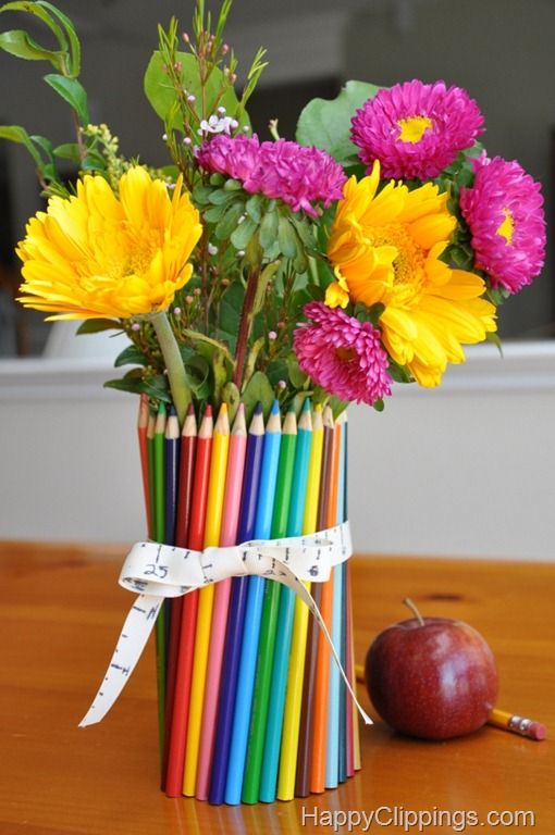 So clever - for teachers gifts. All you need is a container such as a can, colored pencils, a rubber band, a ribbon, a ruler and a black marker or sharpie. And don't forget the water and flowers