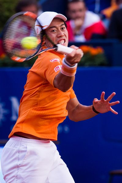 Kei Nishikori Photos - Kei Nishikori of Japan plays a forehand against Rafael Nadal of Spain during their final match during day seven of the Barcelona Open Banc Sabadell at the Real Club de Tenis Barcelona on April 24, 2016 in Barcelona, Spain. - Barcelona Open Banc Sabadell - Day 7
