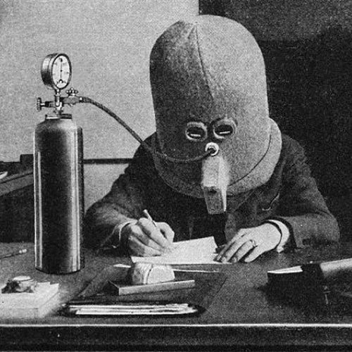 """Isolator- 1925  Invented by science fiction pioneer Hugi Gernsbeck, the """"Isolator"""" was designed to help focus the mind when reading or writing, by rendering the wearer deaf, piping them full of oxygen, not only by eliminating all outside noise, but also by allowing just one line of text to be seen at a time through a horizontal slit."""