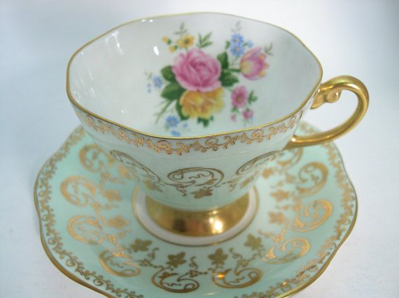 Lovely tea cup and saucer made by Foley England Mint green and gold design with beautiful flowers The backstamp date this set to 1948 - 1963 The tea cup is 2 3/4 high and the saucer is 5 3/8 diameter The rims and handle and the base are gilt. Very good condition, no chips, no