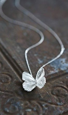 "Quinn pulled a silver chain out of his pocket, and on it hung a silver winged butterfly, as lovely as a crystal. I gasped. ""It's so beautiful..."" He came behind me and clasped it around my neck. It was cold to the touch and gave me a chill. But it was a good chill. ""For us to remember her by."" - Flutterbye"