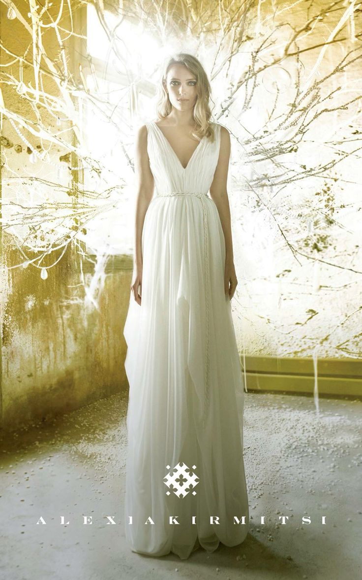 Wedding dress with draped silk satin schiffon fabric. Open back. Feeling of air and flow.