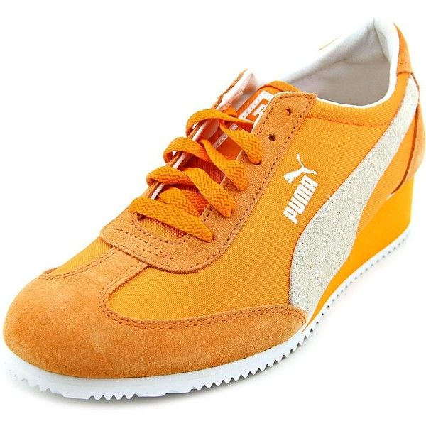 Puma Caroline Women Sneakers ($62) ❤ liked on Polyvore featuring shoes, sneakers, orange, puma trainers, puma footwear, orange sneakers, suede sneakers and synthetic shoes