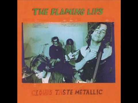 """The Flaming Lips, :Guy Who Got a Headache and Accidentally Saves the World,"""" from the album Clouds Taste Metallic"""