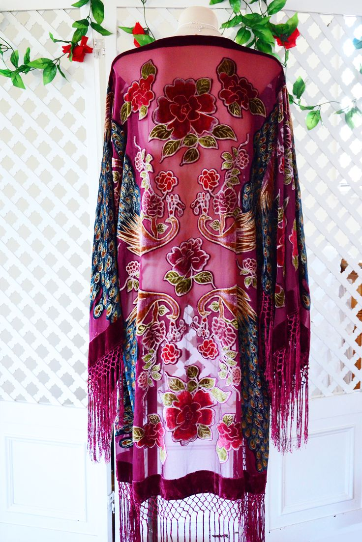 Stunning bohemian 70s inspired burnout velvet kimono. Sheer wine/burgundy tone silk blend fabric (very lightweight) with large kimono sleeves and epic long fringing on sleeve edge and hemline. Gorgeous peacock print! The detail is absolutely exquisite and they feel as lush on as they look! In excellent unworn (new) condition.FREE SIZE fits all.Length: 107cm +fringing: 127cm Underarms (measured along back) 57cm