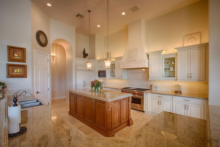 Mix painted cabinets with stained cabinets like this kitchen with Savano in Canvas Paint wall cabinets and Savano with Honey Stain and Brown Glaze Island