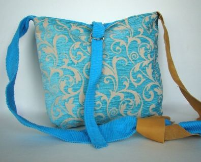 Turquoise tapestry bag; 14 3/4 inches wide X 13 inches tall, total strap length 67 3/4 inches Turquoise outer body reverses to turquoise corduroy the adjustable strap is a combination of turquoise corduroy and deer skin joined with a simple knot.
