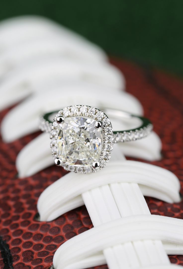 A beautiful Cushion Diamond Halo Engagement Ring in White Gold!