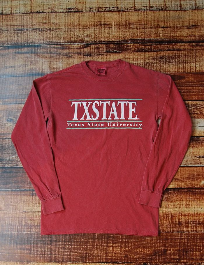Show your spirit on game day in this awesome long sleeve Comfort Color Texas State University t-shirt. Sure, it's simple which makes it perfect for dressing up. GO TXST BOBCATS!