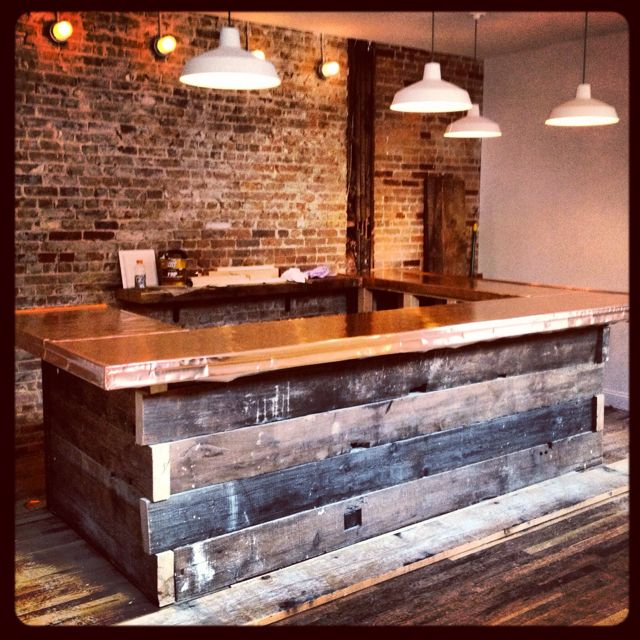 Rustic Bar built using 100+ yr old floor joists. Plywood bar top wrapped in copper. Awesome!