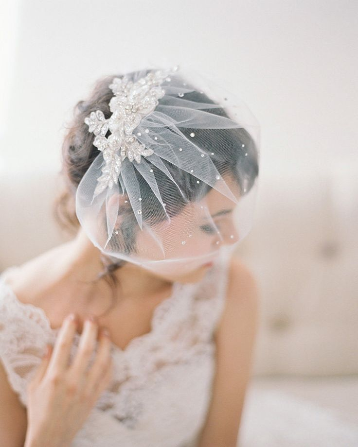 A blusher or short veil is timeless, classic, and extremely versatile. Its light weight and size make it easy to manage, and can go perfectly with any gown. Traditionally blusher veils are short and extend just past the chin; however, nowadays they come in different styles, from a poufy dramatic look to a single layer …