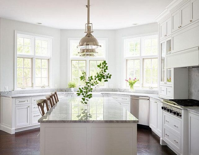 All White Kitchen Marble Countertops With Stainless Steel Hardware Pendant Lighting Decor By Shophouse Design Bay Window