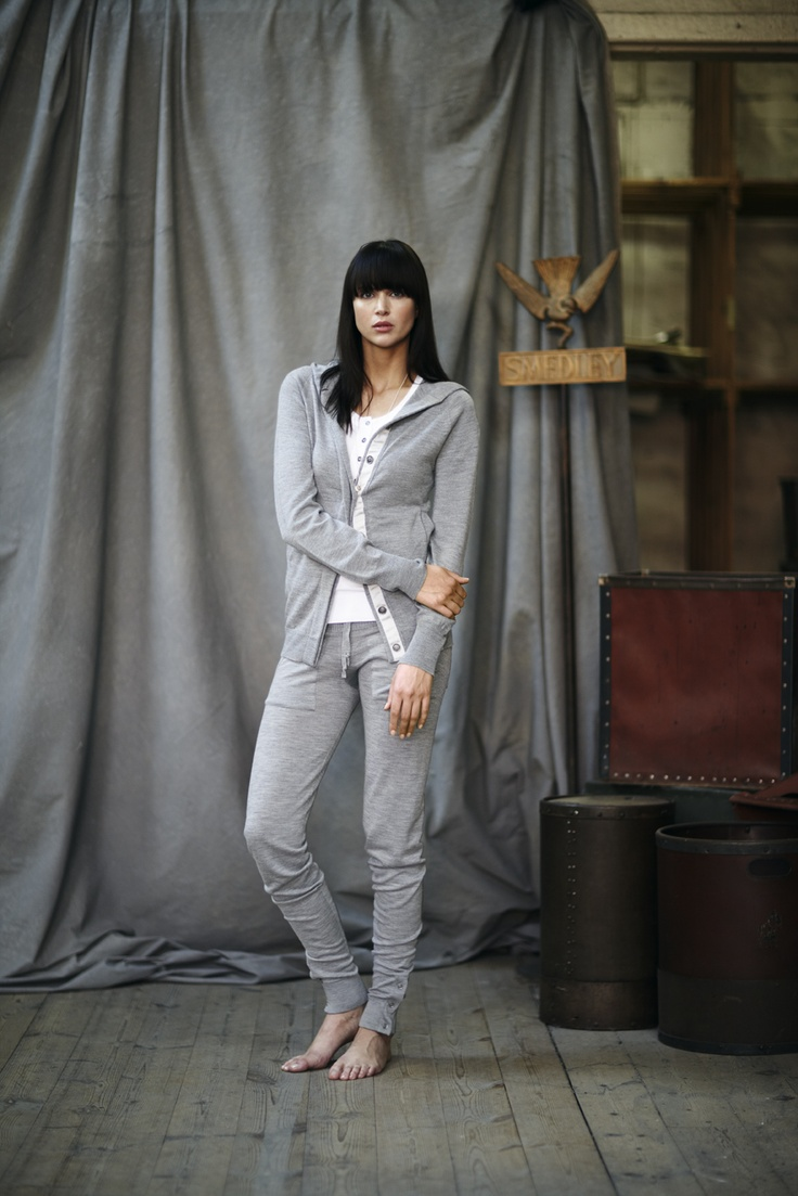 Style 'Cyrus' (hooded jacket) in silver worn with 'Tao' (vest) in white and 'Ola' (pant) in silver