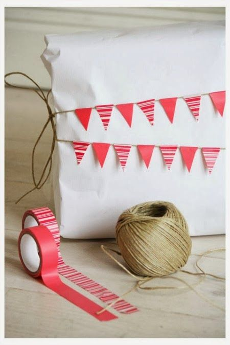 Love this super simple idea for Christmas gift wrapping ... just white paper with tiny washi tape bunting on string ..